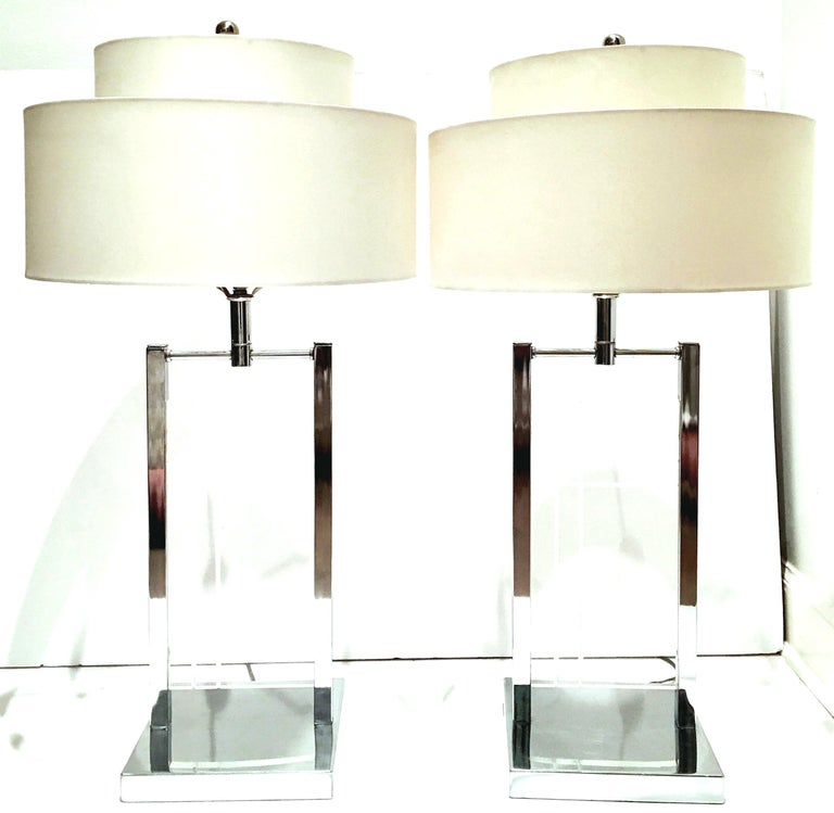 1970'S Pair OF Etched Lucite Panel & Chrome Table lamps By George Kovacs. Features a geometric clean line etched motif on Lucite slab panel with chrome fittings. The Lucite panel measures, 13