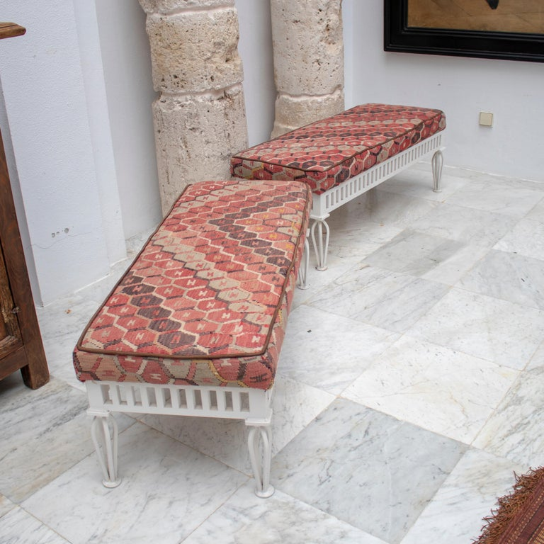 1970s pair of Kilim upholstered iron benches.  Dimensions each: 45 x 126 x 49cm.