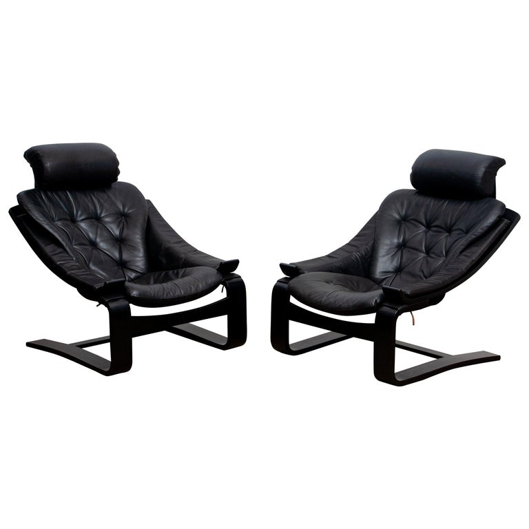 Set of two extremely comfortable black lounge / easy chairs, model