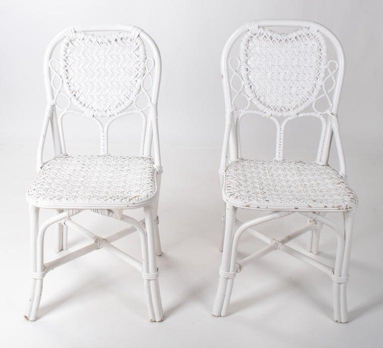 1970s pair of Spanish handmade white wicker wooden chairs.