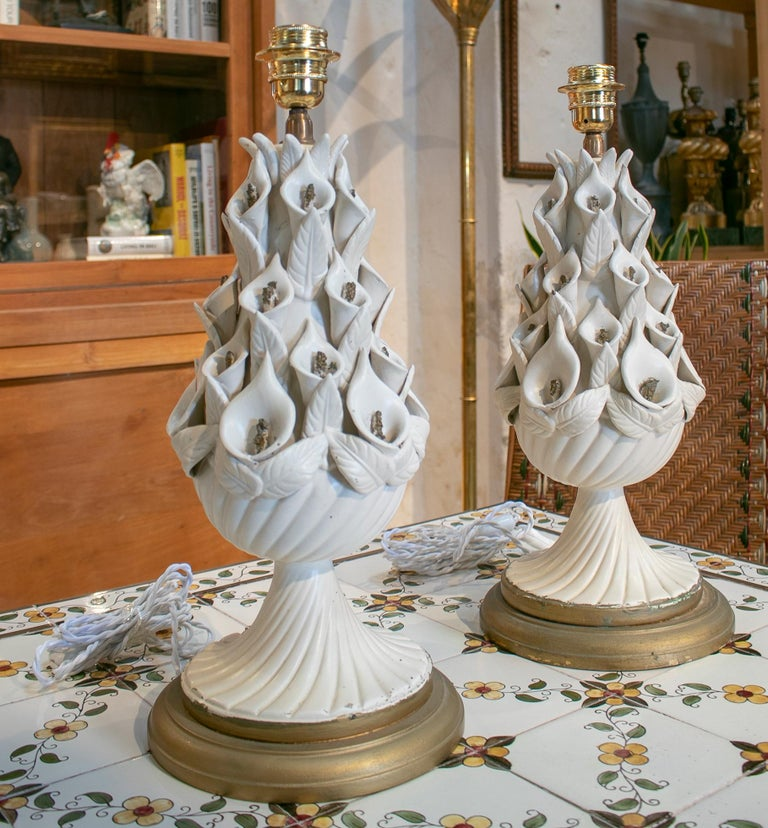 1970s pair of Spanish white porcelain table lamps.