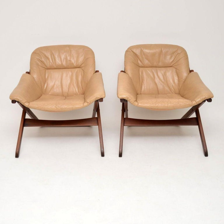 A stylish and extremely comfortable pair of vintage leather armchairs, these were made in Sweden and date from the 1970s. They are in excellent condition for their age, with only some extremely minor surface wear here and there. The leather is