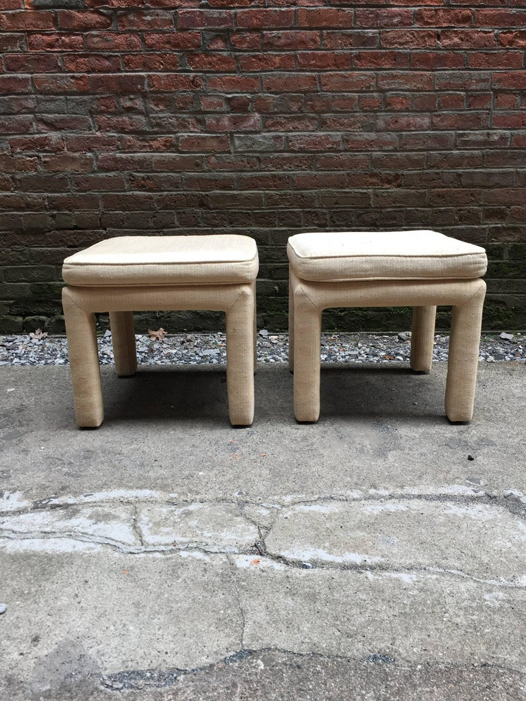Pair of upholstered stools, circa 1970. Upholstered legs and seats. The pair needs to be recovered in any fabric you choose.