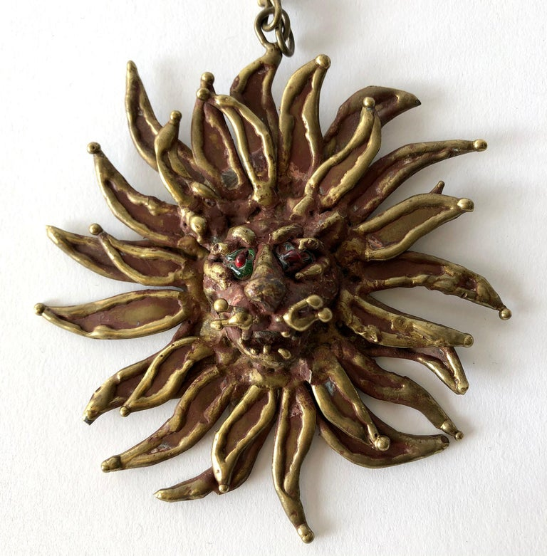 1970's Bronze lion necklace with sun-ray like mane and glass eyes created by Pal Kepenyes of Acapulco, Mexico.  Pendant measures 5
