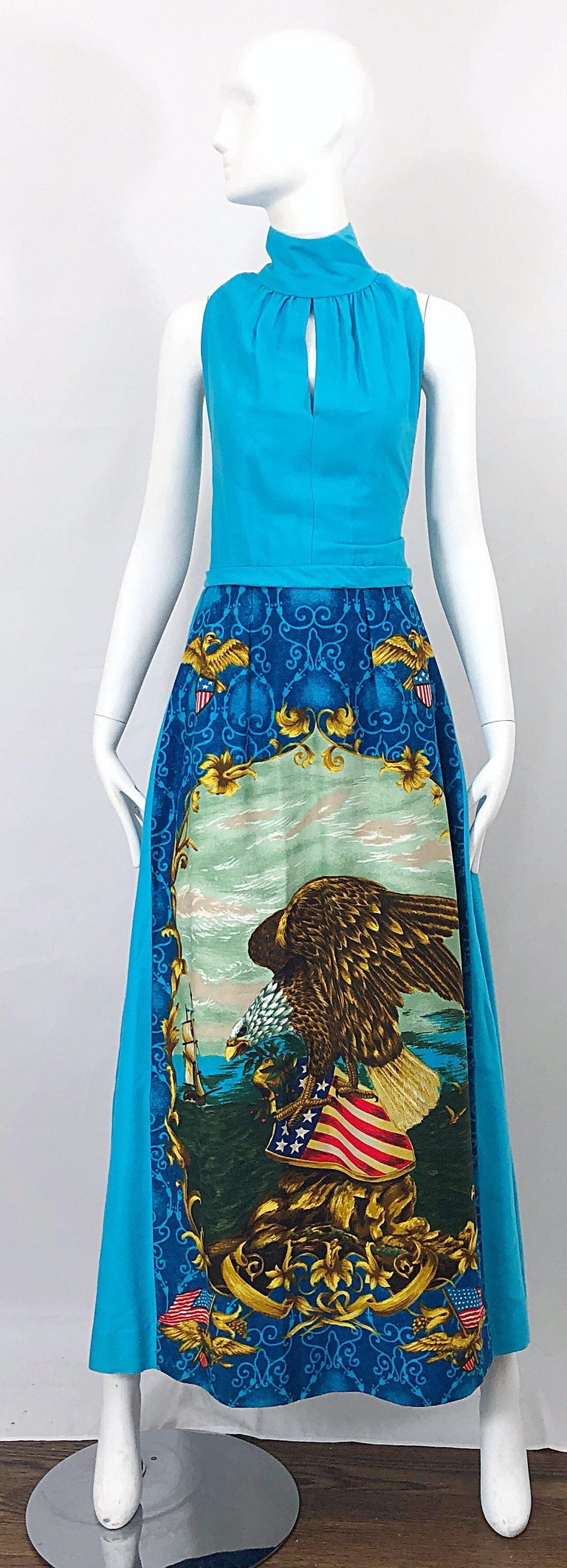 Incredible vintage 1970s patriotic maxi dress! Turquoise blue base, with vibrant colors of red, white, blue and gold throughout. Peek-a-boo cut out above the bust, with a high neck. Print on the front skirt is also on the back skirt. Soft felt