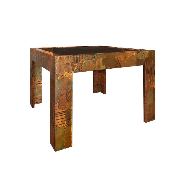 Paul Evans style patchwork metal cocktail table in copper, brass and pewter, USA, 1970s.