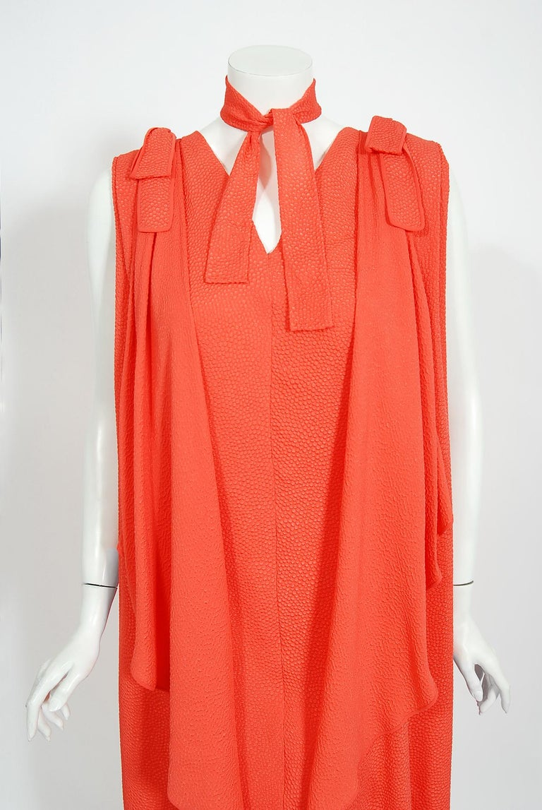 A gorgeous and vibrant Philippe Venet haute couture orange silk caftan dress dating back to the early 1970's. Venet famously worked as an assistant to Elsa Schiaparelli from 1951 to 1953, and then worked beside Hubert de Givenchy at his couture