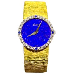1970s Piaget 18 Karat Yellow Gold Lapis Diamond Sapphire Bracelet Watch