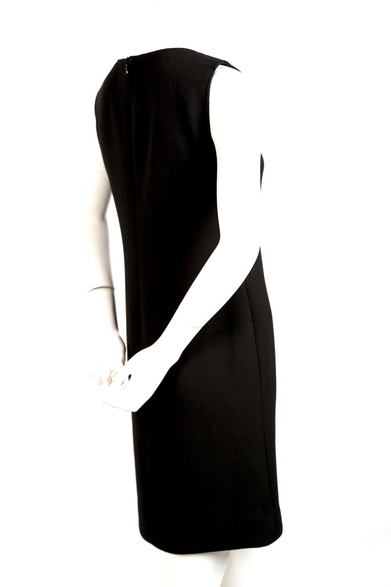 Black 1970's PIERRE CARDIN haute couture wool shift dress with circular cut-outs