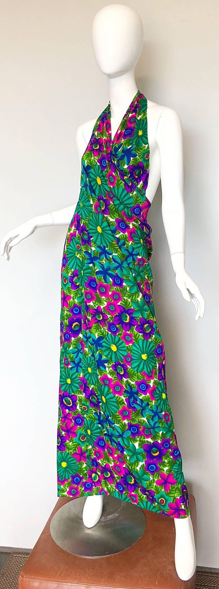 Chic, yet versatile POMARE of HAWAII brightly colored floral wrap halter maxi dress! Soft cotton blend, with bright colors in purple, pink, blue, fuchsia, green and yellow. Criss crosses around the neck and ties at top back neck. Can also be used as