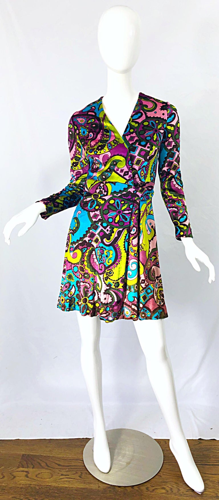 Amazing 1970s psychedelic paisley print colorful velour wrap dress ! Features vibrant colors of pink, blue, green, turquoise, chartreuse green and purple throughout. Interior ties on the left side of the waist, with hook-and-eye closure on the