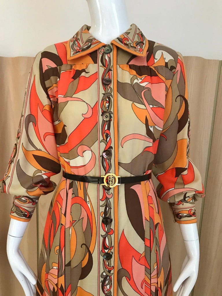 Vintage 1970s Pucci light wool in multi color print in orange, brown, creme and pink. Dress comes with original belt. Dress is not lined however it is not itchy. Size: Medium/ US 6  **** There are some minor distressed on the fabric near the label