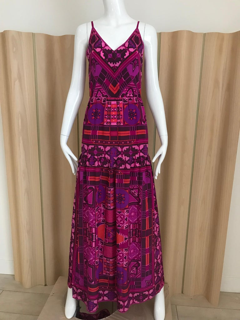 Vintage 70s multi color print in magenta and purple silk spaghetti strap V neck maxi dress from Bonwit Teller. Perfect for cocktail party. Bust: 34 inches/ waist: elastic stretch up to 30 inches  / HIp: 37 inches/  Dress length is 60 inches