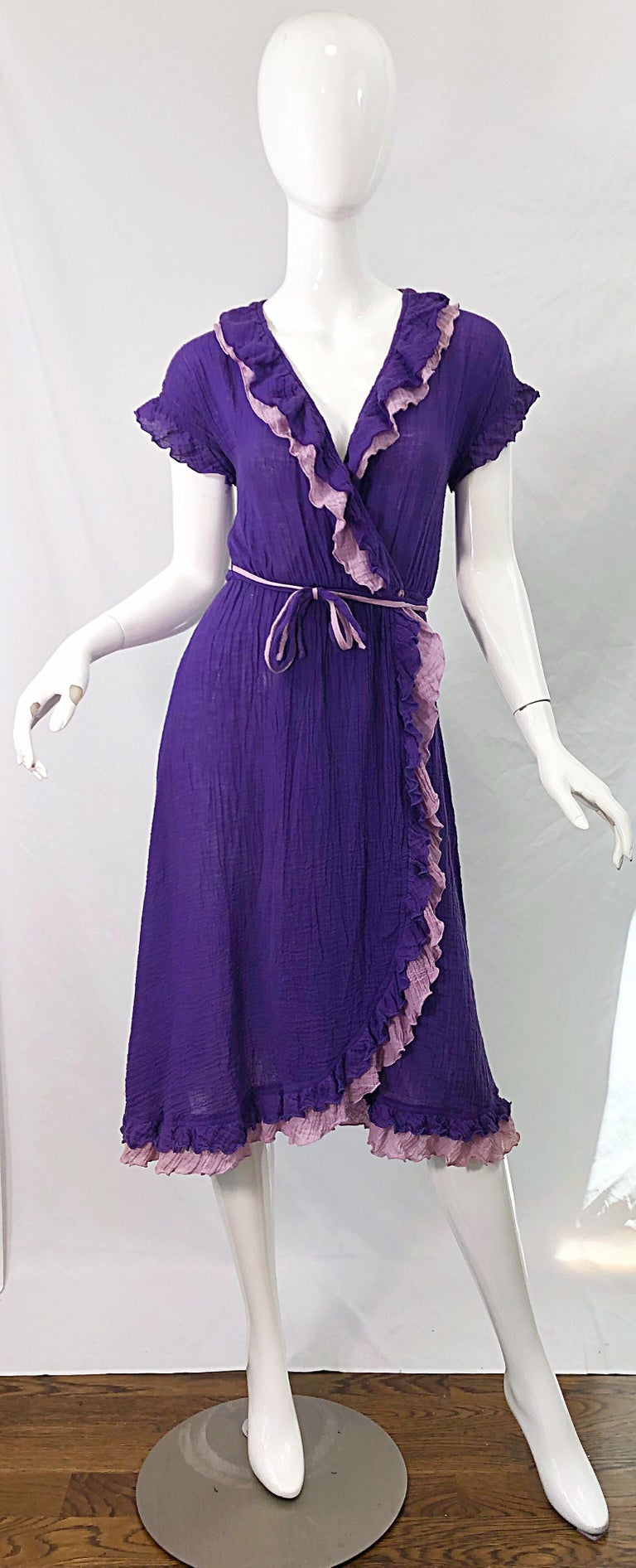 Amazing 1970s purple and lavender lightweight cotton voile short sleeve wrap dress ! Features a vibrant regal purple with lavender ruffle details. Elastic waistband. Both colors on each of the belts. Light and breezy perfect for any time of year.