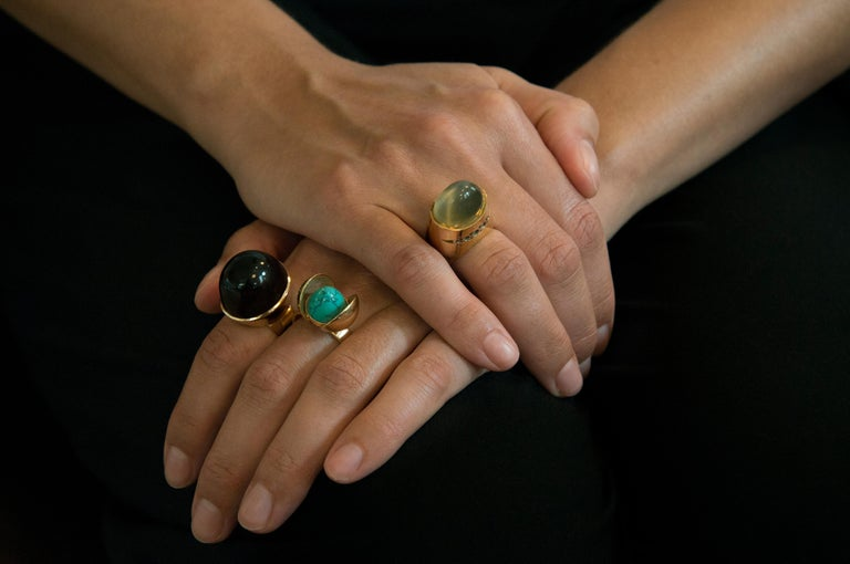 A turquoise and 18 karat gold ring, by Age Fausing. c. 1970   The ring is a size 8 and sizeable. It is stamped Fausing, Denmark and 750.  Fausing was a Danish studio for whom all the leading designers made jewelry. It was active only for a short