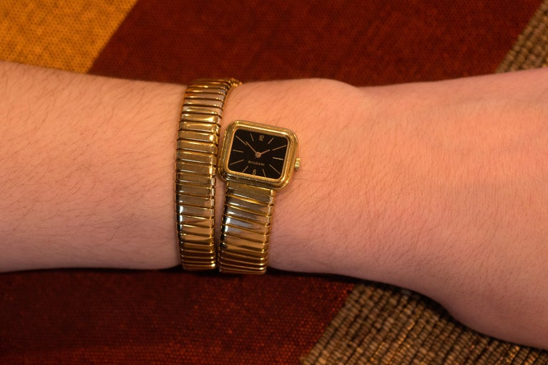 This is an 18 karat gold serpenti tubogas watch with black dial, by Bulgari, 1970s. It has a manual movement and is stamped Bulgari G1113 4, 15777. The bracelet watch is approximately 1.5