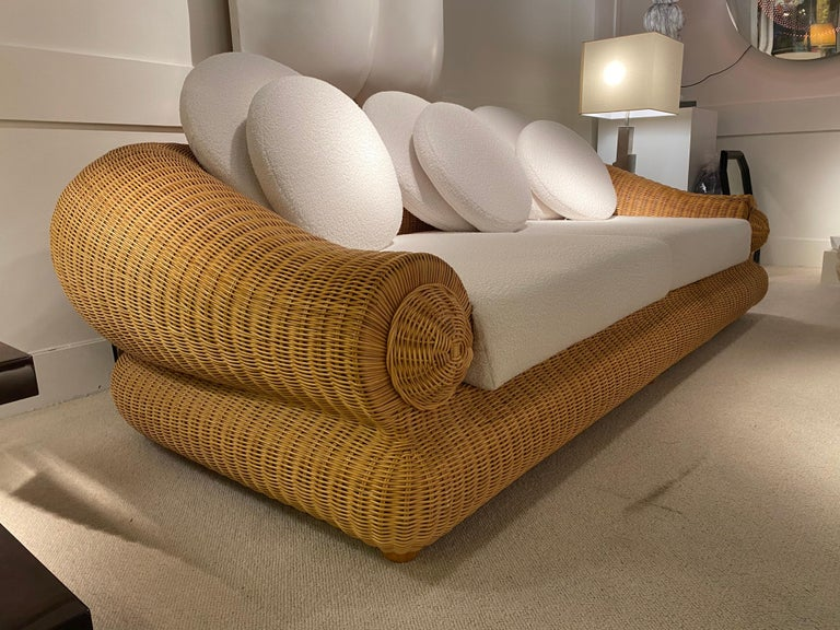 1970s rattan vintage sofa with rounded shape. Great condition Reupholstered with white fabric.
