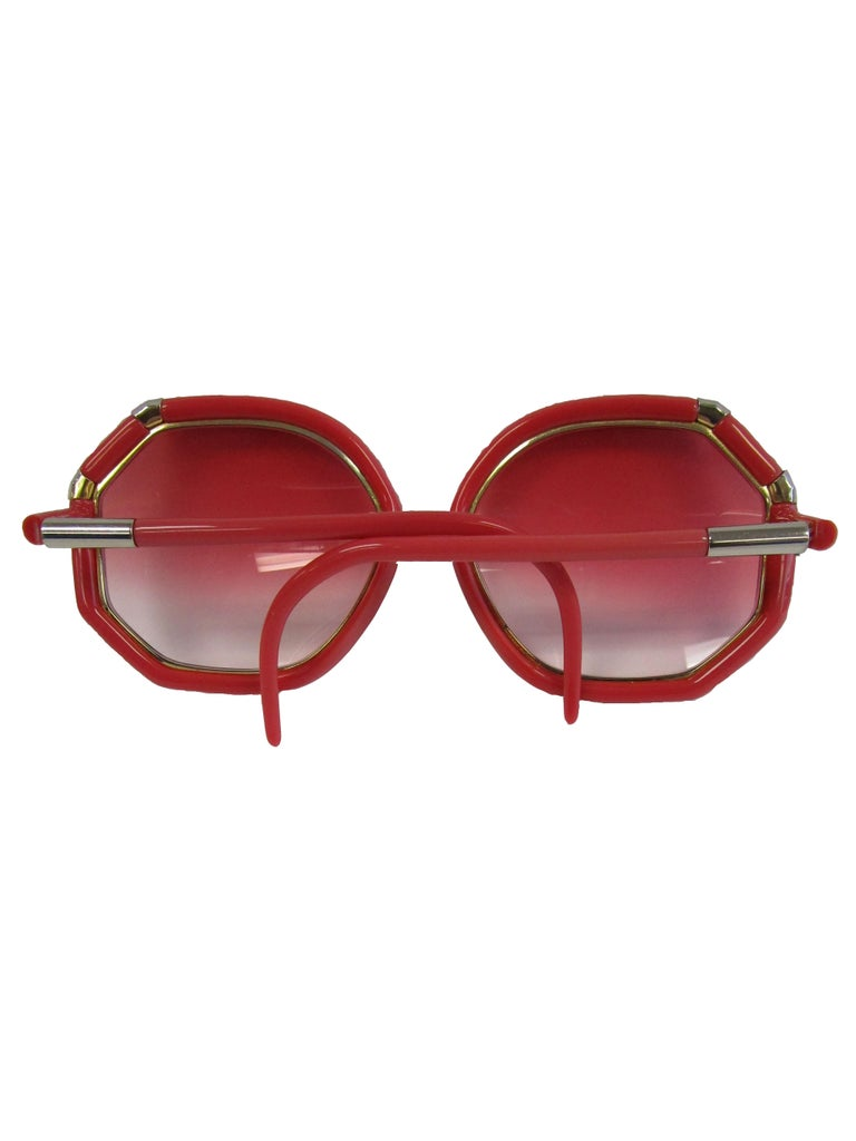Check out theses spectacular 1970's Red Ted Lapidus sunglasses featuring an octagonal frame silver/gold hardware and rose ombre lenses that keep you looking cool all summer!  bridge : .5 in lens : 2.5 in arm : 4.5 in