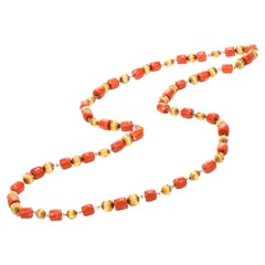 1970s Red Natural Coral Beads 18 Karat Gold Strand Necklace
