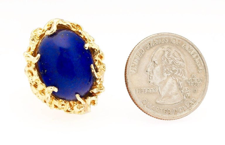 Stunning retro 1960's - 1970's 14 karat gold large and very blue Lapis Lazuli naturalistic free form cocktail ring.  The yellow gold open work organic style ring is set with a beautiful blue cabochon cut Lapis Lazuli, measuring 20x15mm on its own.