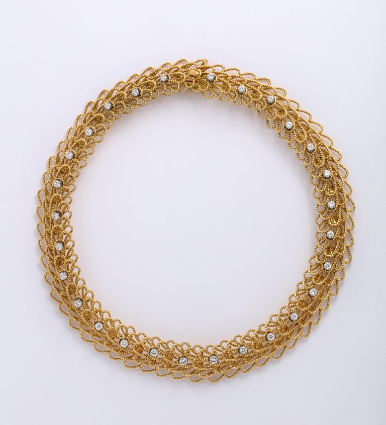 18k Gold 1970's Necklace with Earrings is a unique twisted Wire design, the necklace will sit beautifully on any neck due to its mobility.   Necklace and Earring Set 16 Inches  145 Grams total weight of 18k Gold Necklace is 125 Grams w/ 28 diamonds