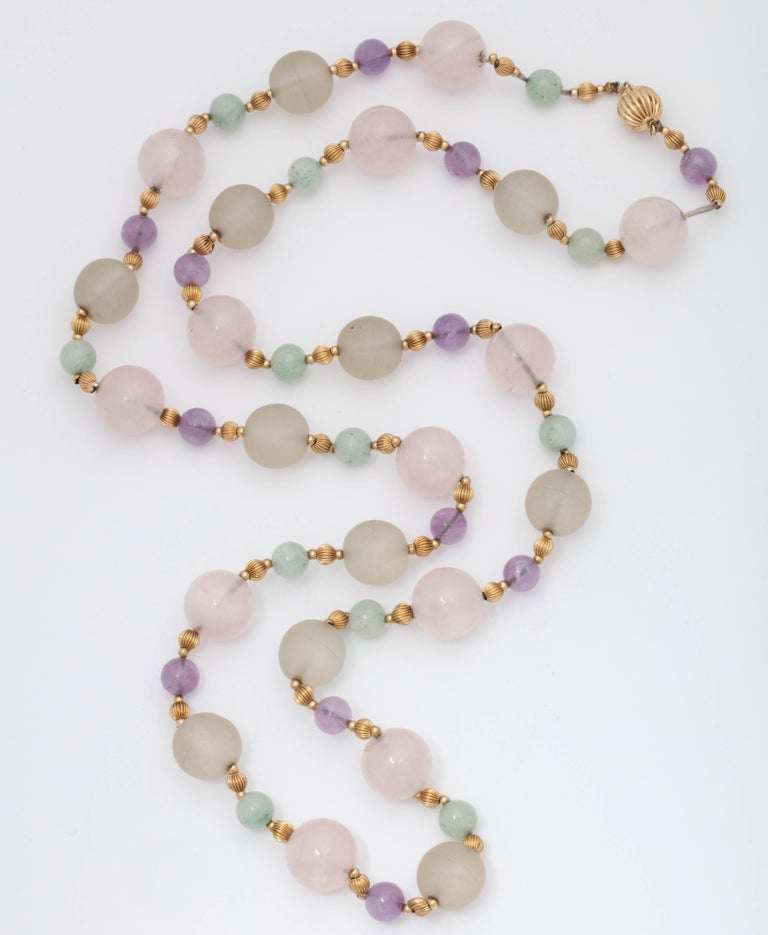 One Ladies 14kt Yellow Gold Necklace Created With Numerous Rock Crystal Beads Measuring Approximately 10MM Each. Further Designed With Alternating Amethyst Beads Measuring 6MM Each,Also Created With Numerous Jade Beads Measuring Approximately 6MM