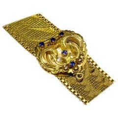 1970s Rolex 18 Karat Yellow Gold Sapphire Concealed Textured Bracelet Watch