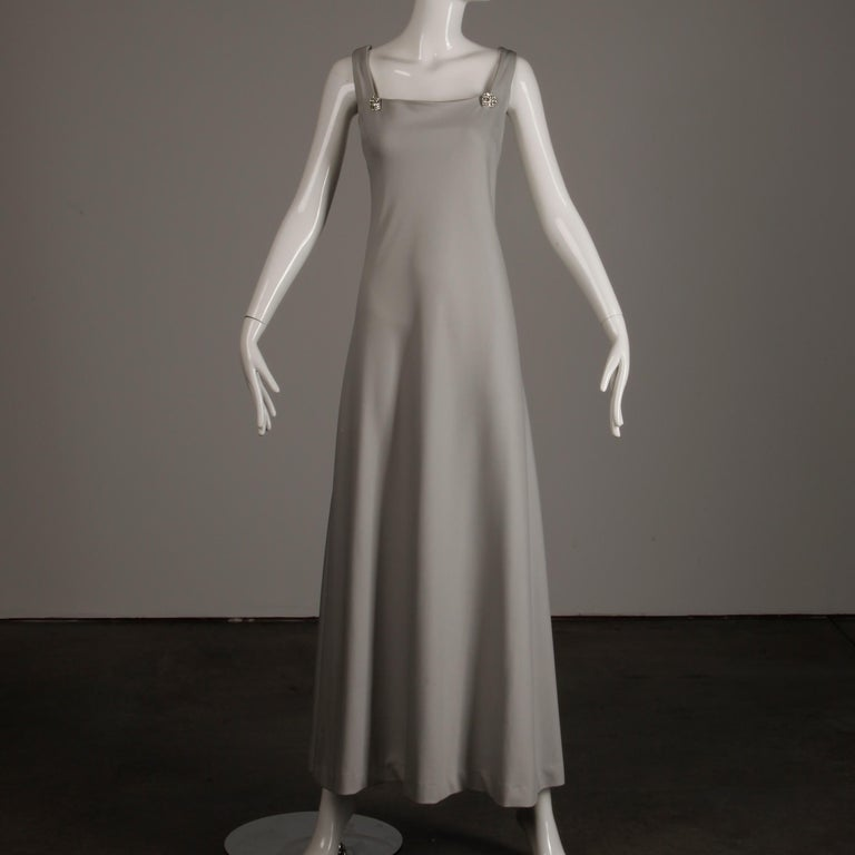 Unlined with rear zip and hook closure and hook closure affixing rhinestones from the dress to the cape. The marked size is 12, and the ensemble fits like a modern medium-large. The bust measures 41
