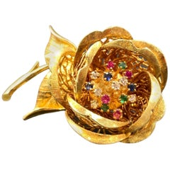 1970s Ruby, Emerald, Diamond and Sapphire Flower Pin, Made in 18 Karat Gold