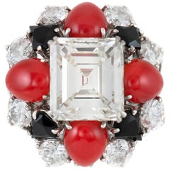 1970s Ruser Ring with Center GIA Emerald Cut Diamond, Coral and Onyx