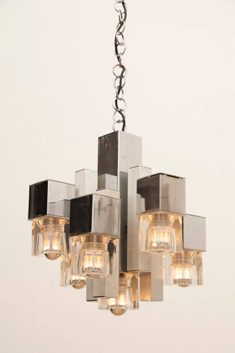 1970s Italian abstract cubic ceiling hanging light designed by Gaetano Sciolari. The staggered cubic shapes which are made of chromed metal and aluminium with heavy glass cubes at the end of each one. A screw-in E14 bulb is required within each