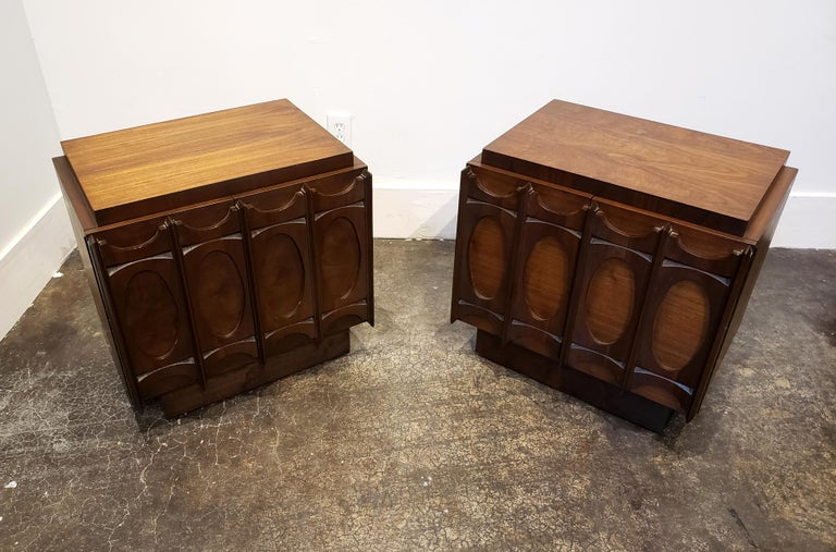 Brutalist 1970s walnut wood nightstands with strong sculptural, Brasilia-style front. Would be a stunning addition to any setting, traditional or modern.