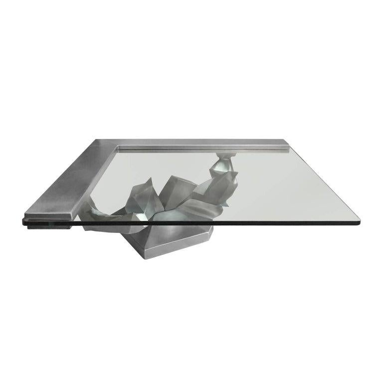 Sculptural brushed stainless steel coffee table, French, 1970s.