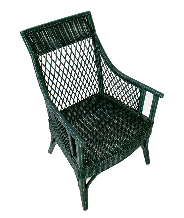 1970s set of 6 Spanish woven wicker chairs painted in black.