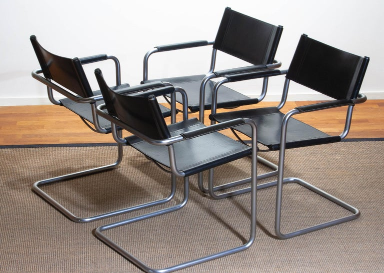 1970, perfect set of four dining / office chairs made by Matteo Grassi, Italy. The chairs have tubular titanium look steel frames with sturdy black leather seating and backrest. They are signed on the back of the backrest. Overall condition is