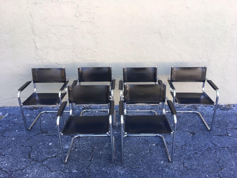 A beautiful set of six dining chairs in style of Mart Stam Bauhaus leather MG5 by Matteo Grassi, Italy. The chairs have tubular titanium look steel frames with sturdy black leather seating and back and armrest. The chairs are in a very nice