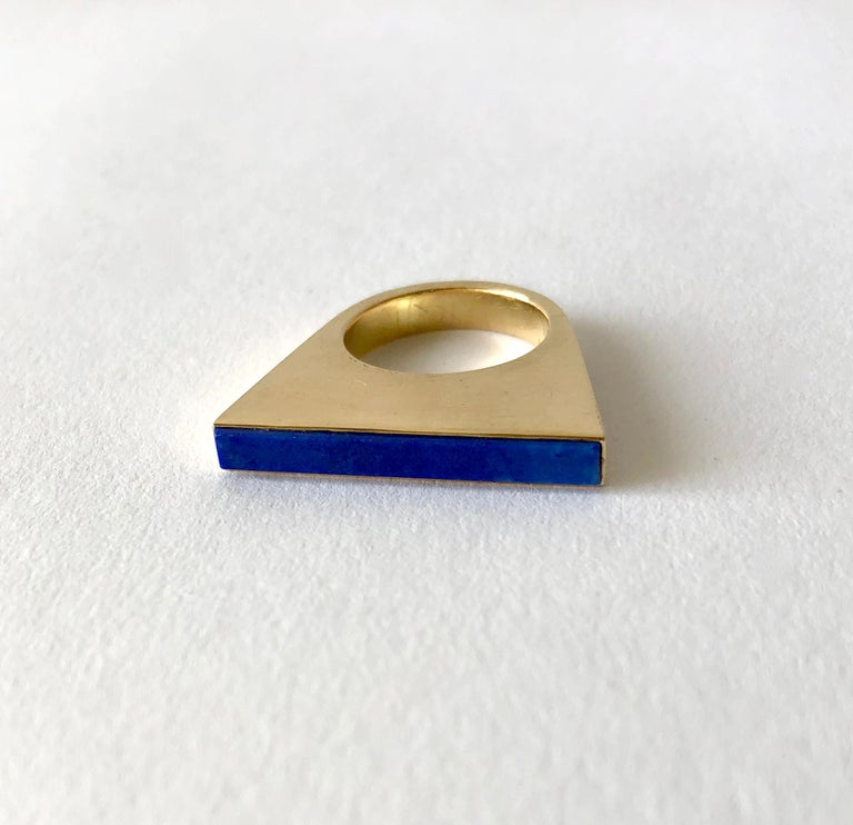 Lapis lazuli and 18K gold ultra modernist ring created by sculptor and goldsmith Sigurd Persson of Stockholm, Sweden.  Ring is a finger size 5.5 and is signed with Swedish hallmarks, X9 (1972), 18K.  In very good vintage condition showing signs of