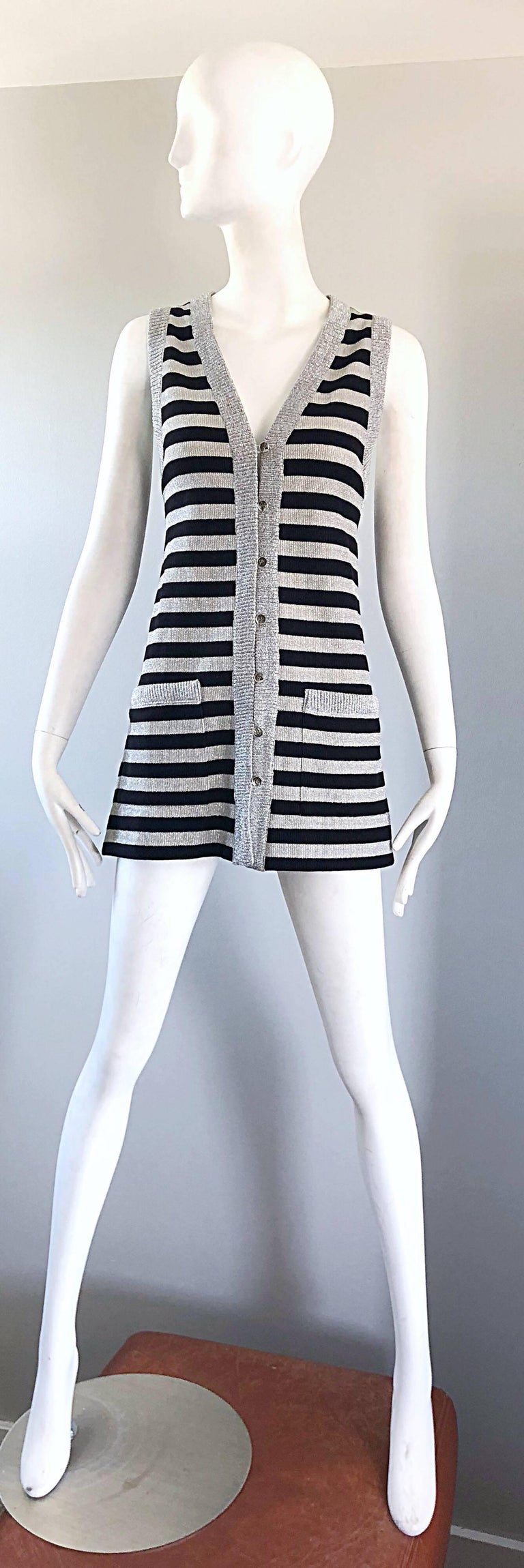 Chic 70s silver and black metallic striped sleeveless tunic vest OR mini dress! Silver buttons down the front make this piece perfect for layering (or on its own). Pockets at each side of the waist. Great belted or alone. In perfect