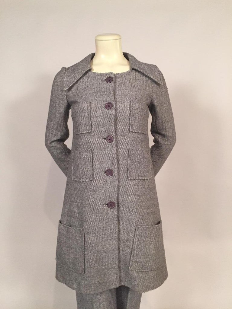A soft grey wool tweed is used for this coat and pant ensemble from Sonia Rykiel. The coat has six patch pockets, a functional and decorative element.  There are grey buttons and bound buttonholes at the center front and on the cuffs. The coat has a