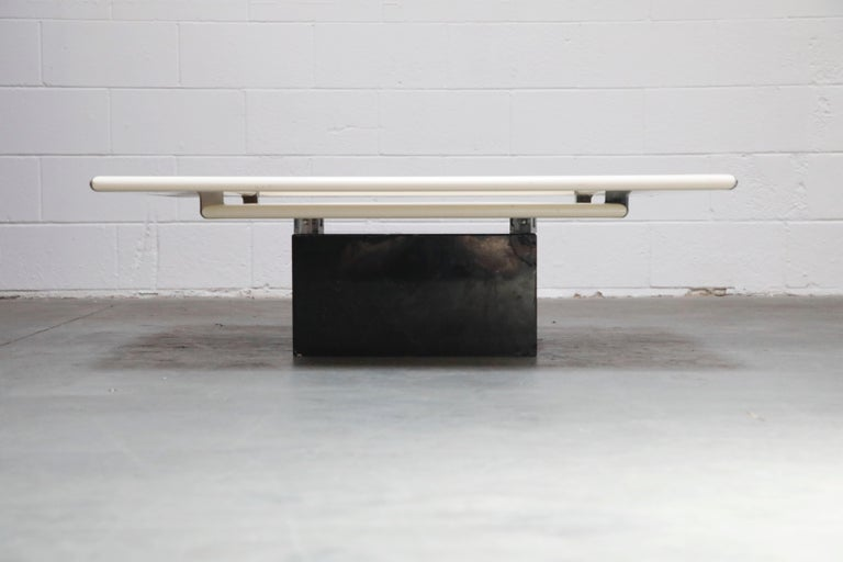 Such a cool and unique design, this futuristic space age mod B&B Italia coffee table features two tiers of lacquered wood and steel over a square marble base.   This would work great in a Post-Modern, Mid-Century Modern, Space Age Mod,