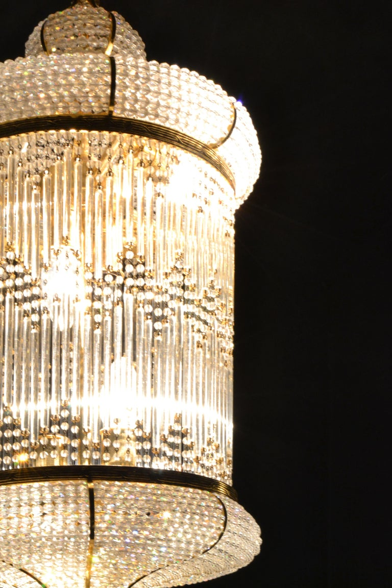 Midcentury style lantern / chandelier crafted from gilt brass and Swarovski Crystal.  Designed and made in Valencia by the Spanish designer Salomé Català-Andrés in the 1970s.  This piece can add an elegant touch to any space.  Takes 10 Edison E14