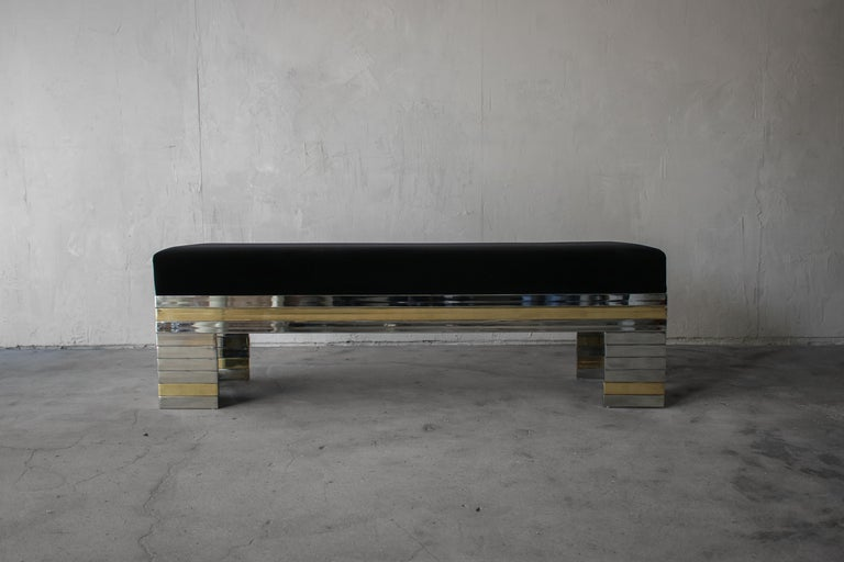 Absolutely stunning stacked, mirrored chrome and brass bench. The bench is authentic vintage, from the 1970s. This bench is beautiful and adds so much class to any space. It is perfect almost anywhere, entry, foot of a bed or as additional seating