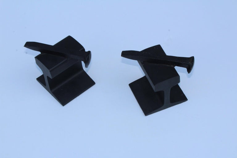 1970s modern steel railroad beam bookends, with steel nail top.
