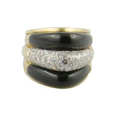1970s Stylish 18 Karat Onyx and Diamond Ring