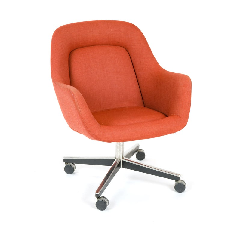 A desk chair with the original channel-stitched upholstery, on an X-form caster base.