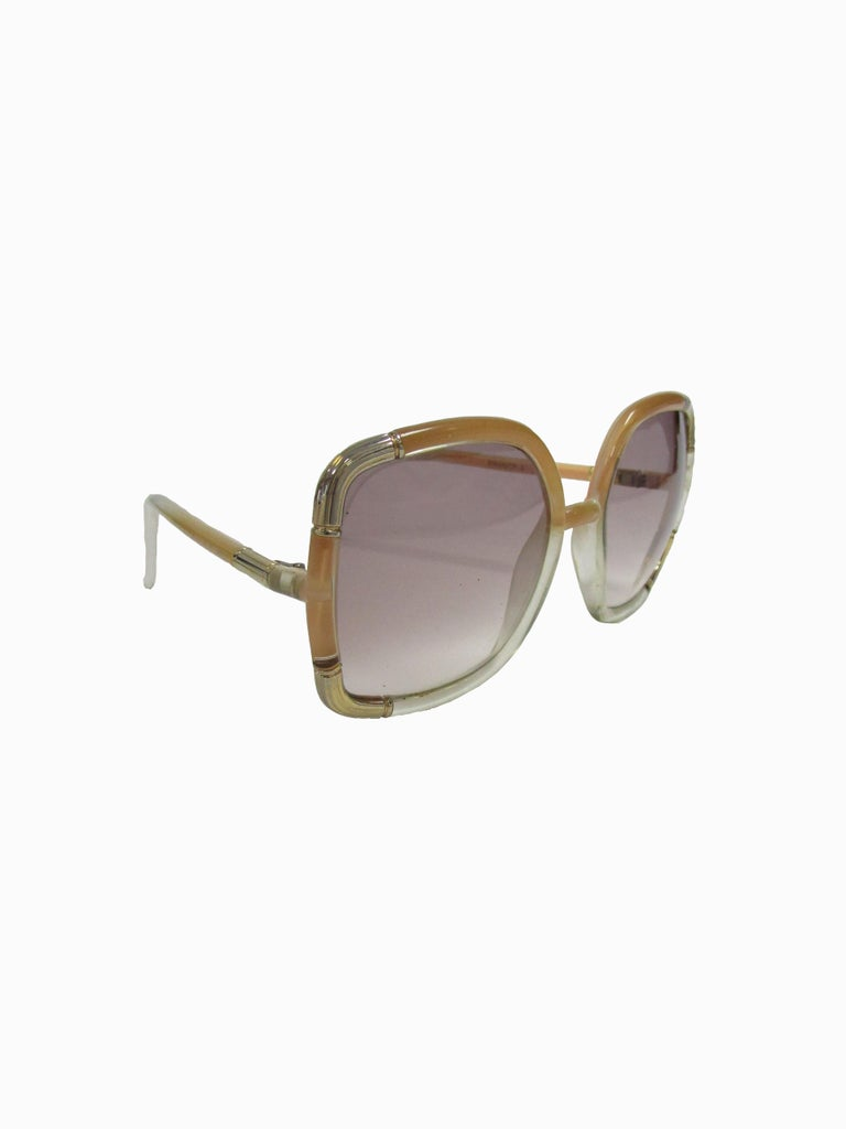 Classic Ted Lapidus sunglasses with nude beige to clear gradient and gold hardware around the eye.  Lens Width-57mm Bridge Width- 15mm Temple (arm) Length - 5in