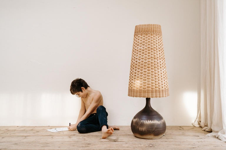 Typical 1970s vintage lighting, terracotta with original wicker lampshade ... can be used as floorlamp or tablelamp.