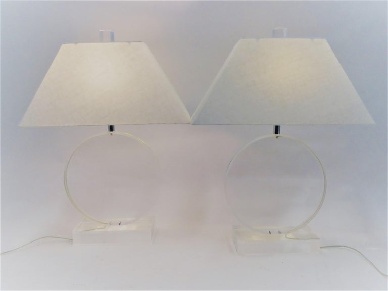 Exceptional 1970s pair of Mid-Century Modern thick Lucite Disc Springer style lamps signed Marlee with restored shades. Lucite in very good clean vintage condition. Great Lucite finials. Concealed wiring. Slight age markings. Large, the disc is 15