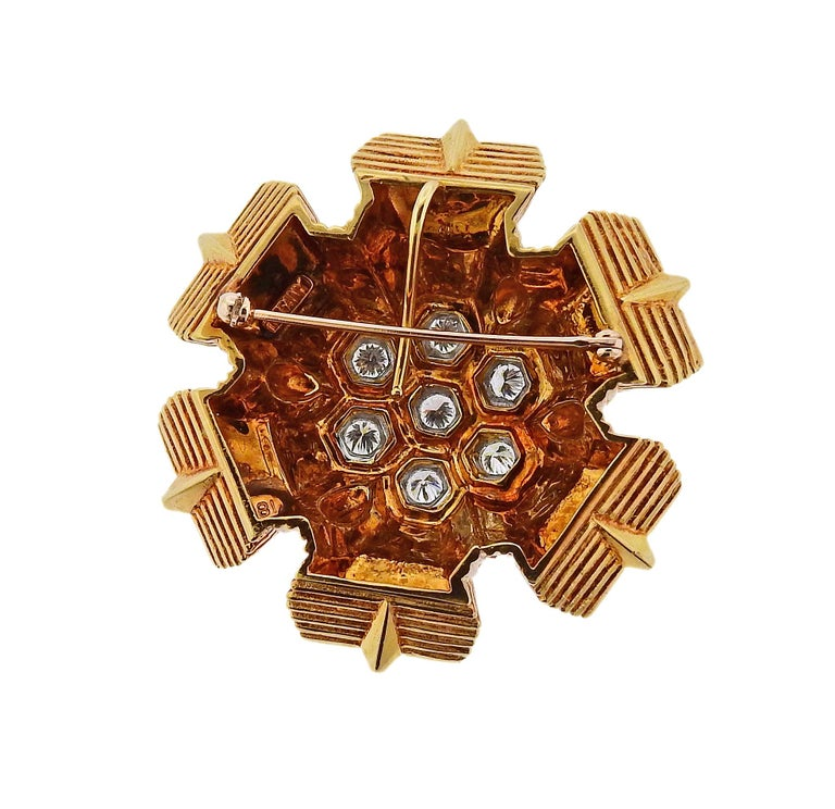 Large circa 1970s 18k gold brooch pendant, crafted by Tiffany & Co,set with approx. 1.40ctw in G/VS diamonds set in a honeycomb center.  Brooch/pendant is 48mm x 48mm. Weight is 45.3 grams. Marked Tiffany & Co, 18k .