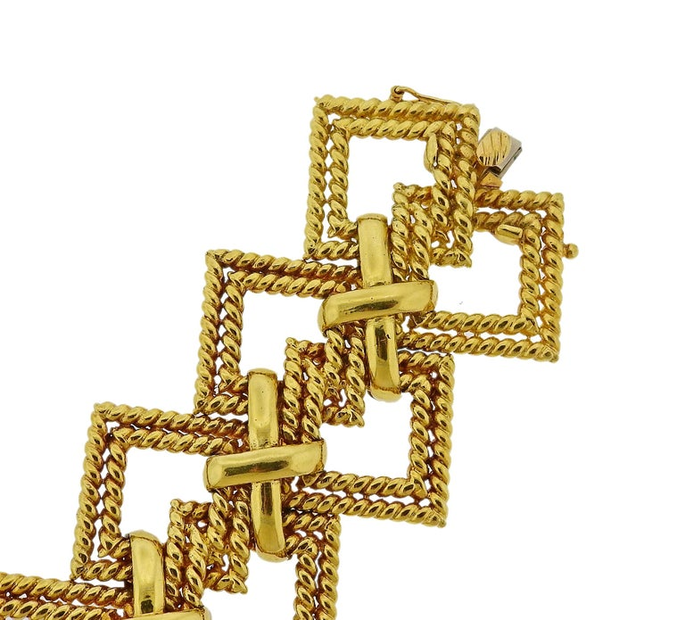 Massive 18k yellow gold wide x bracelet by Tiffany & Co, crafted in circa 1970s. Bracelet is 7.75